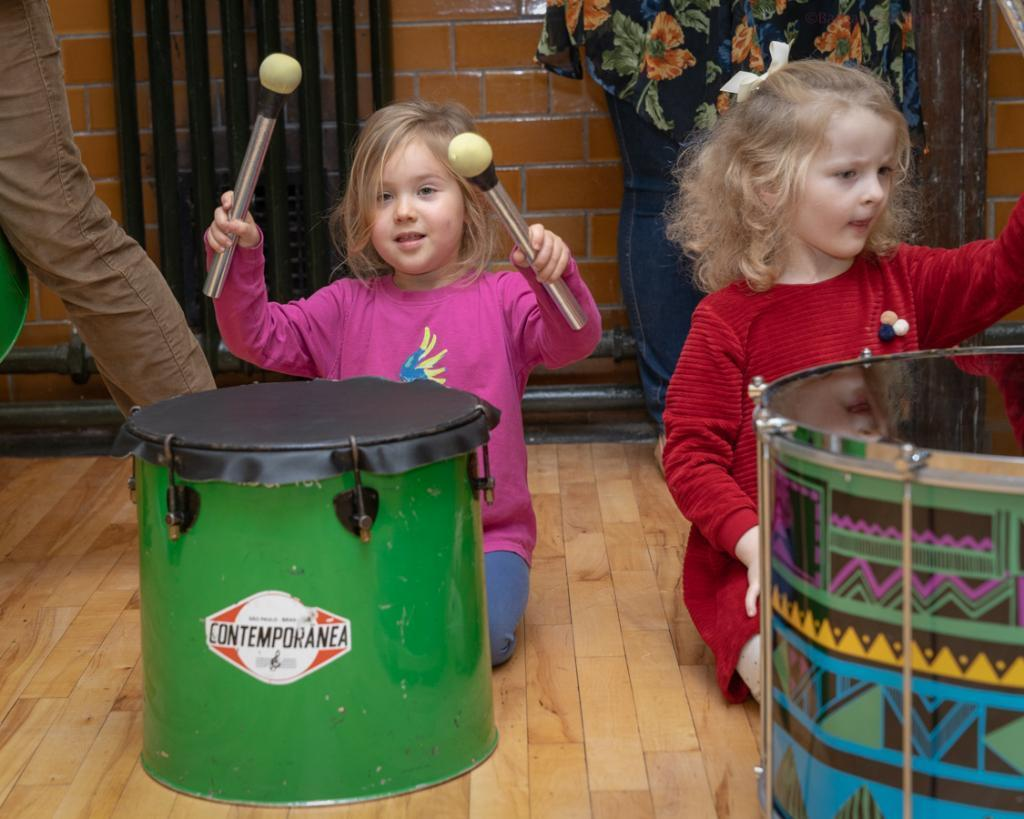 two small girls drumming