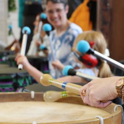 happy women and child playing drums